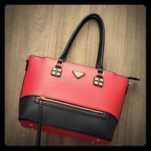 Red and black purse with shoulder strap